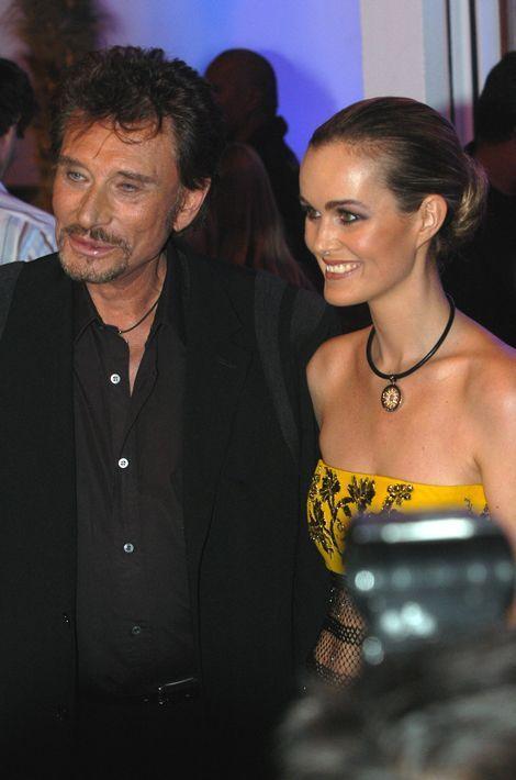Johnny et Laeticia à l'entrée de l'Amnesia, octobre 2003