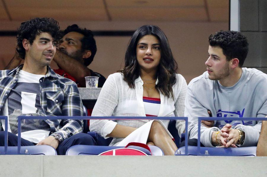 Joe Jonas, Priyanka Chopra et Nick Jonas à l'US Open, à New York le 4 septembre 2018