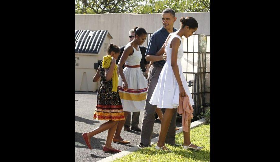 Barack Obama était entouré de sa femme Michelle et de leurs filles Sasha (à gauche) et Malia (à droite).