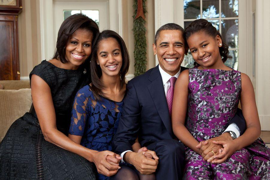 Michelle et Barack Obama avec leurs filles Malia et Sasha, en décembre 2011.