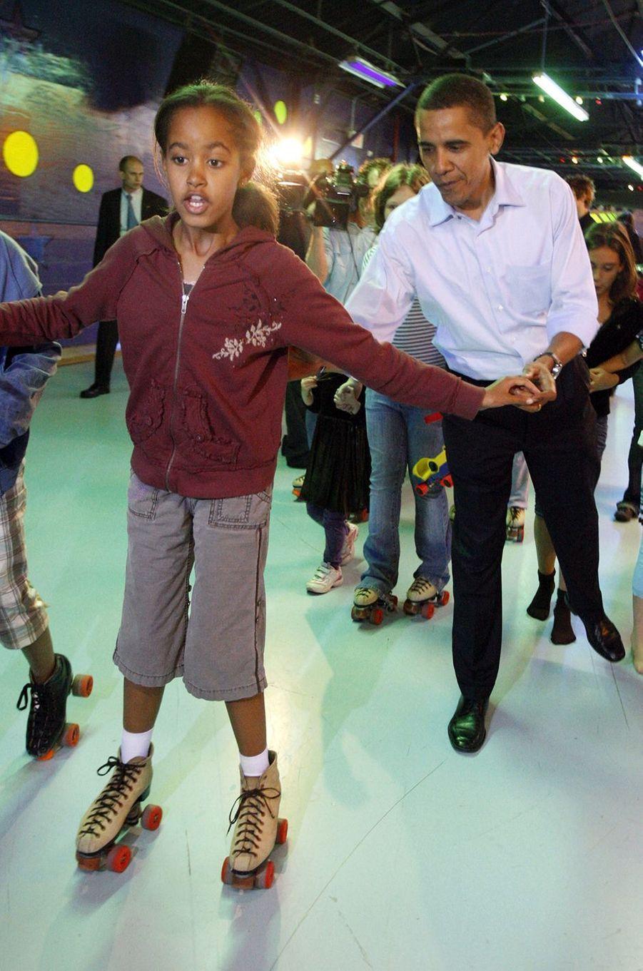 Barack Obama et sa fille Malia, en mai 2008.