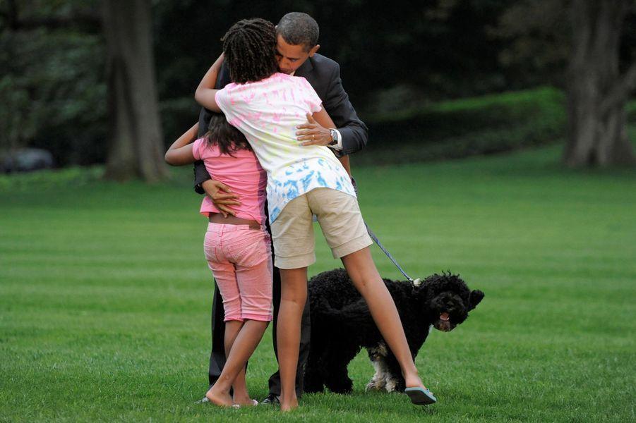 Sasha, Malia et Barack Obama, en septembre 2009.