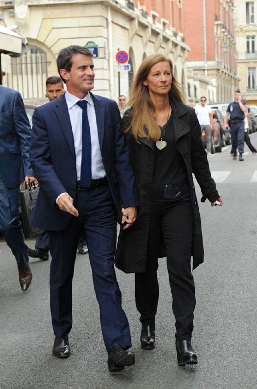 Manuel Valls et Anne Gravoin arrivant au Nouvel An juif de Marek Halter à Paris, le 28 septembre 2014