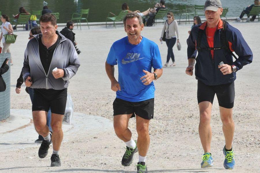 Nicolas Sarkozy : séance de jogging dans le parc des Tuileries le 10 septembre 2014