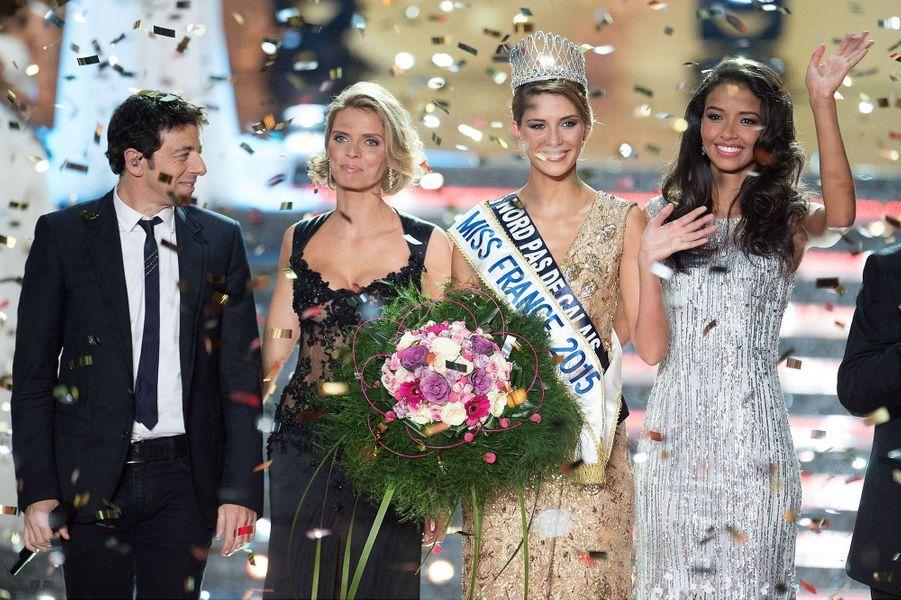 Camille Cerf (au côté de Patrick Bruel, président du jury, Sylvie Tellier et Flora Coquerel, Miss France 2014)lors de son sacre à Orléans le 6 décembre 2014