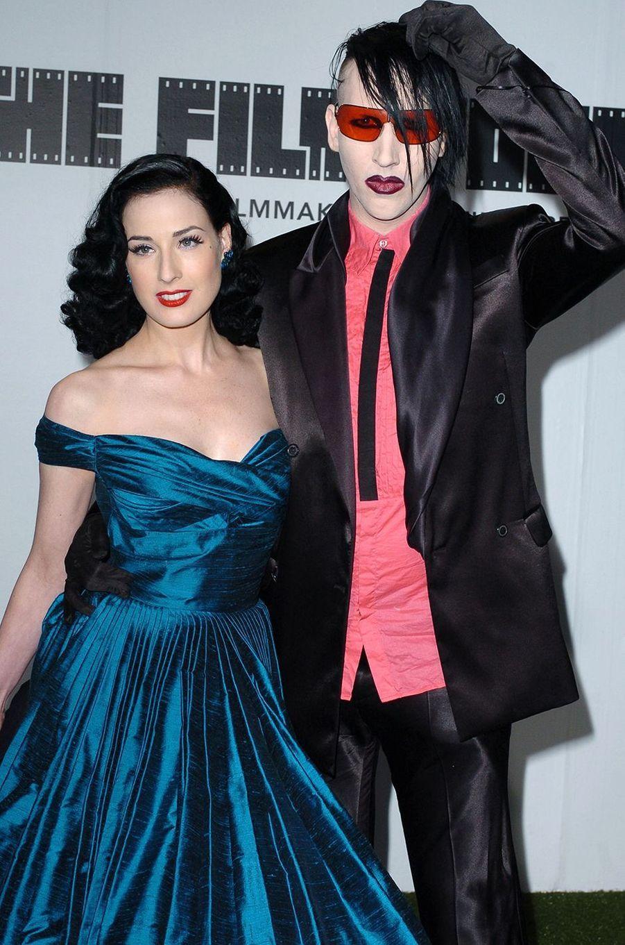 Dita Von Teese et Marilyn Manson lors d'une présentation de la maison Marc Jacobs à New York en mars 2005