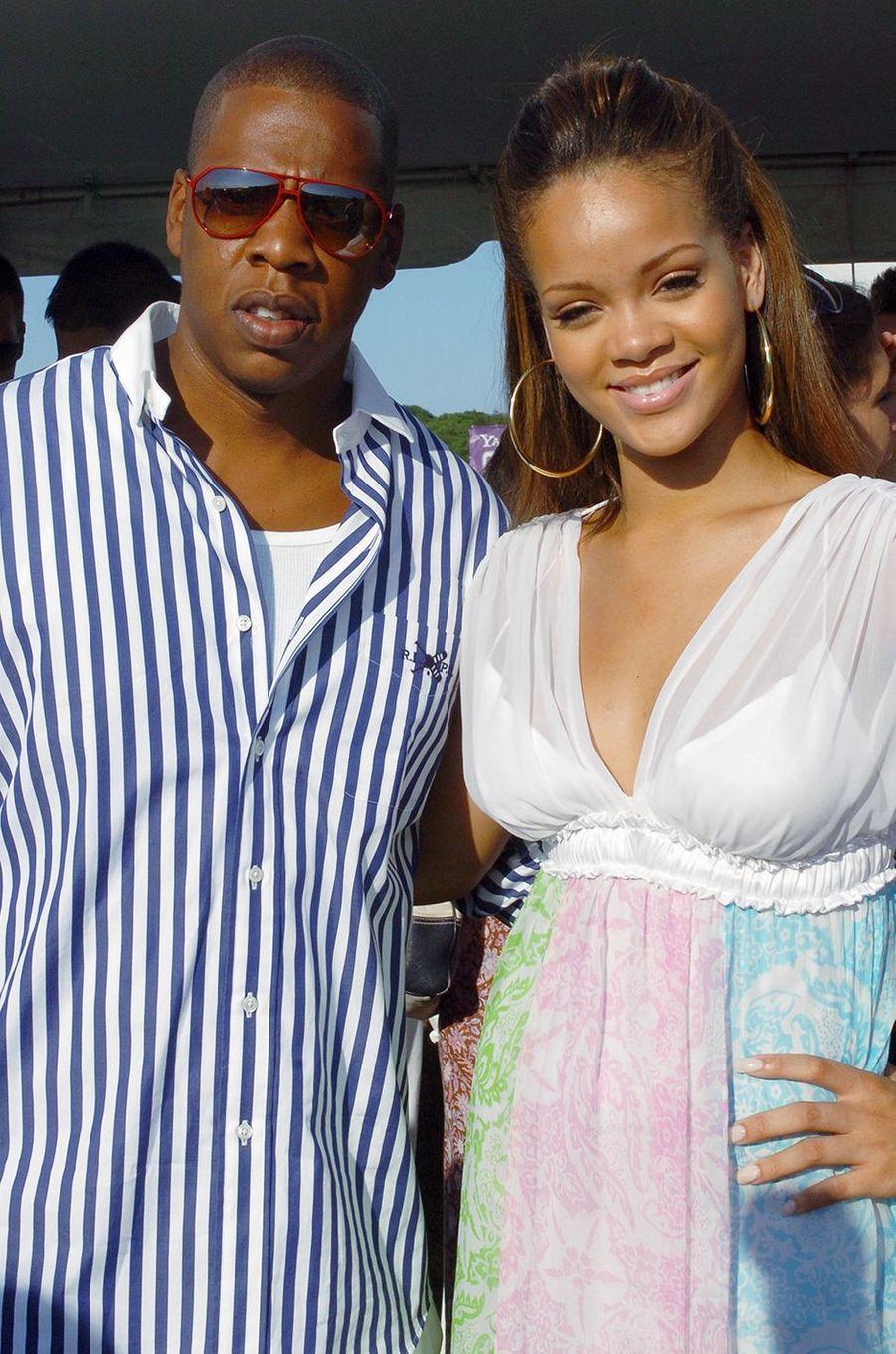 Rihanna au côté de son mentor Jay-Z lors d'un événement organisé à New York par son label Def Jam en juillet 2005