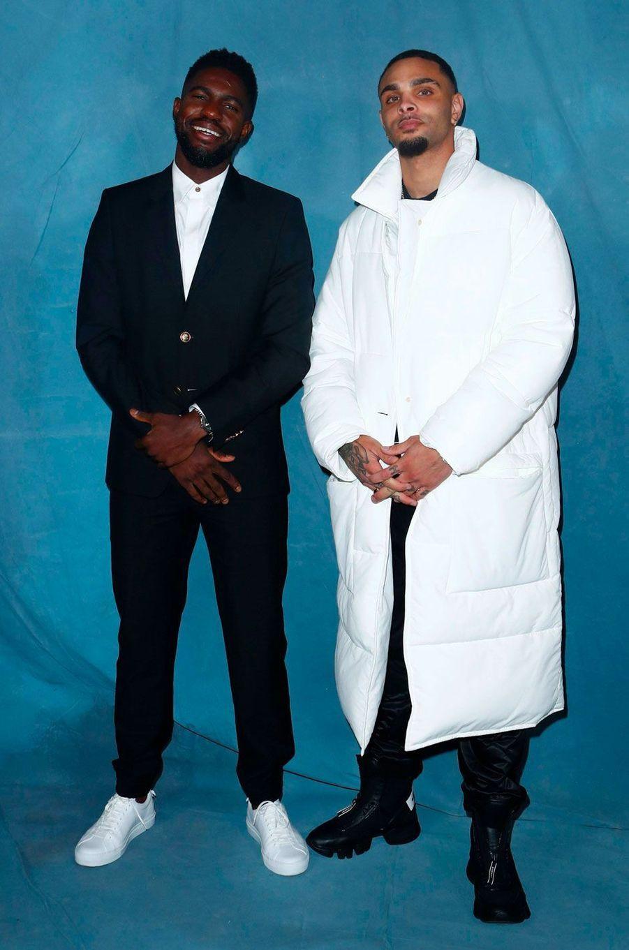 Samuel Umtiti et Layvin Kurzawaau défilé Givenchy à Paris le 30 septembre 2018