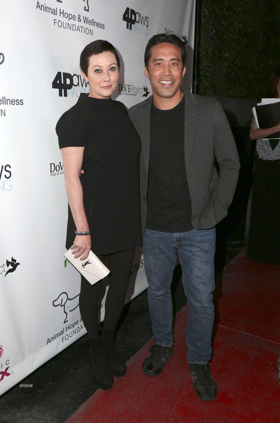 Shannen Doherty sur le tapis rouge avec Marc