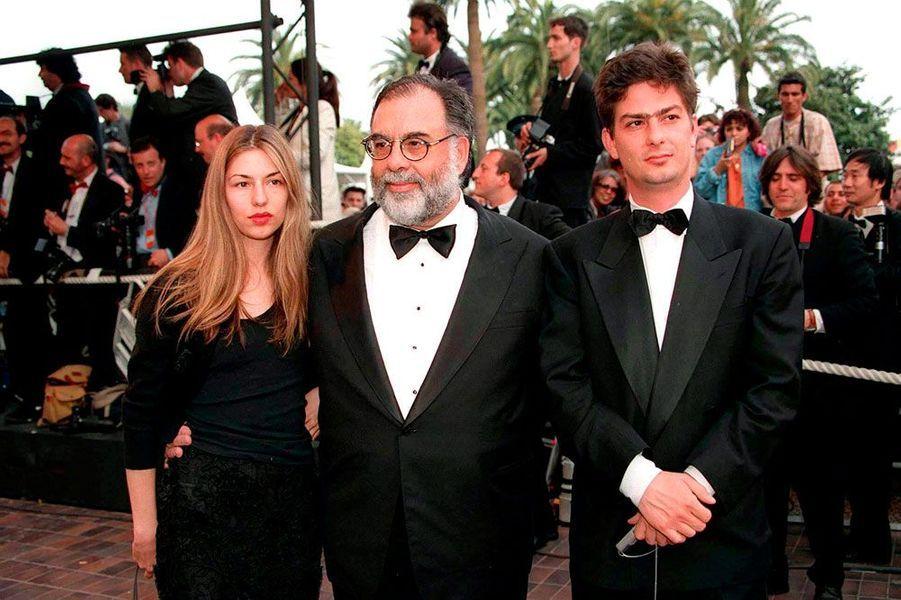 Francis Ford Coppola, Sofia et Roman à la montée des marches du film d'Arnaud Desplechin «Comment je me suis disputé» en 1996.