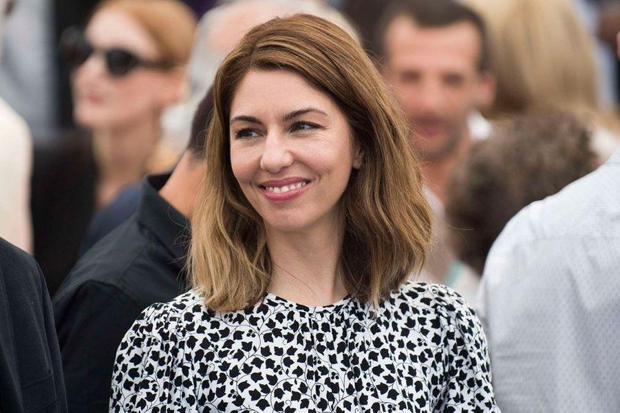 En 2017, pour le 70ème Festival de Cannes, Sofia Coppola pose pour la photo des palmés.