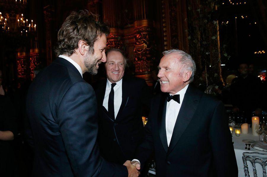 Bradley Cooper, François-Henri Pinault et François Pinault à Paris le 9 mars 2016