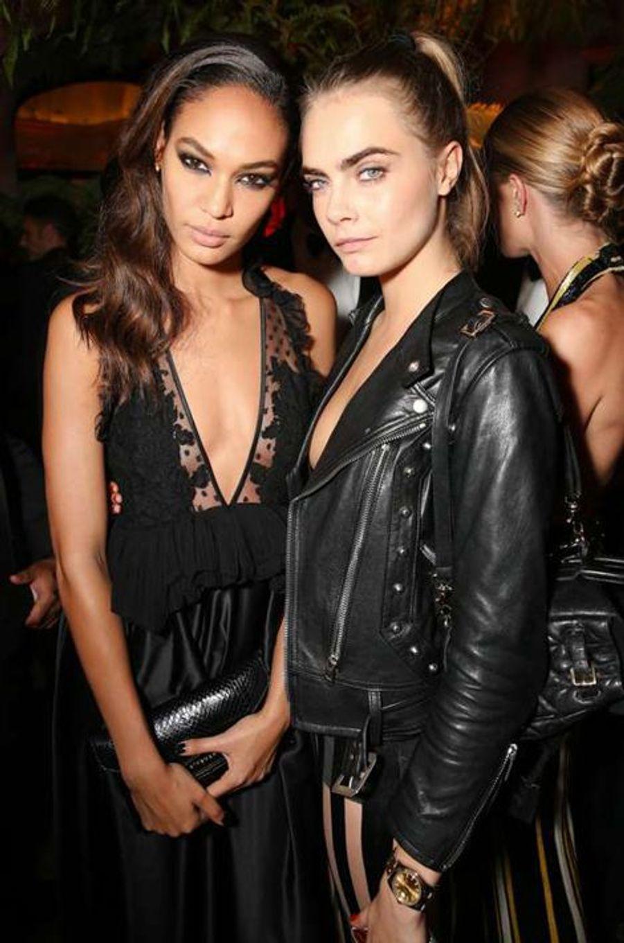 Joan Smalls et Cara Delevingne à la soirée CR Fashion Book organisée à Paris le mardi 30 septembre 2014