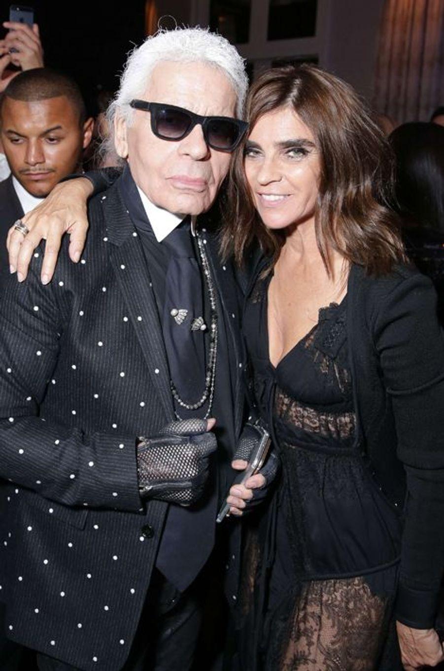 Karl Lagerfeld et Carine Roitfeld à la soirée CR Fashion Book organisée à Paris le mardi 30 septembre 2014