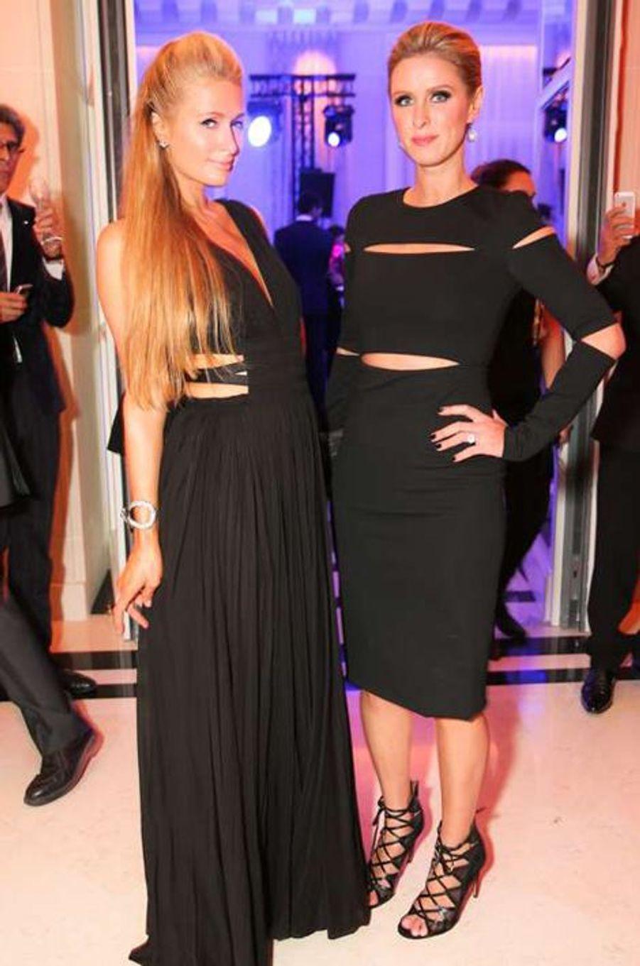 Paris et Nicky Hilton à la soirée CR Fashion Book organisée à Paris le mardi 30 septembre 2014