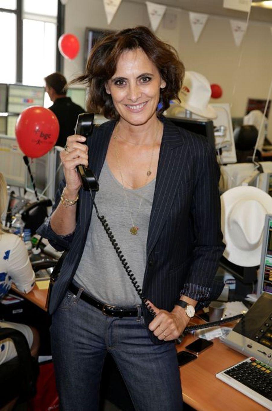 Inès de la Fressange mobilisée pour le Charity Day à Paris le 11 septembre 2014.