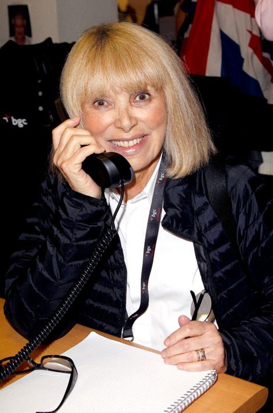 Mireille Darc mobilisée pour le Charity Day à Paris le 11 septembre 2014.