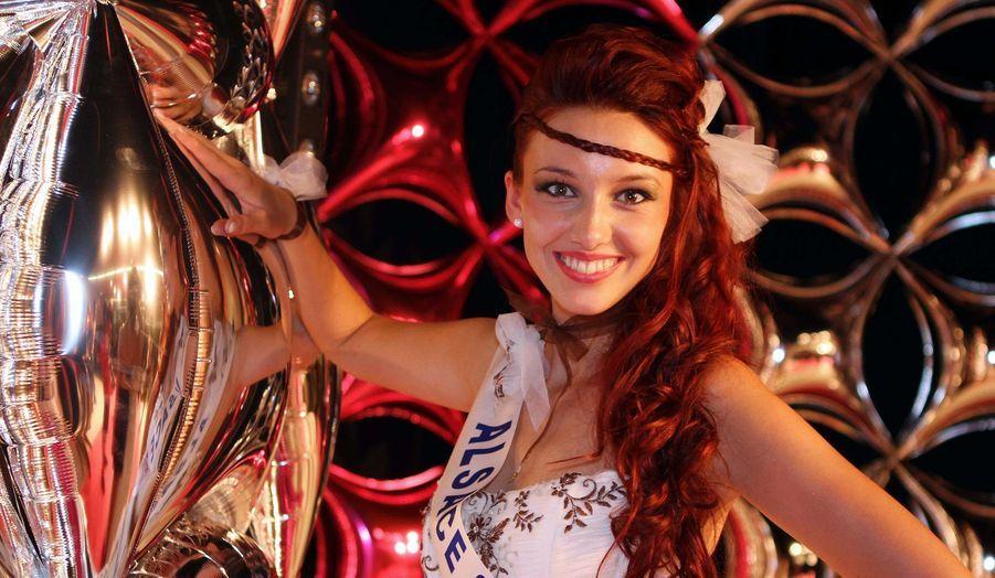 Dans une interview accordée aux Dernières Nouvelles d'Alsace, la jeune femme de 19 ans a admis s'être inscrite au premier concours de beauté, l'élection de Miss Haut-Rhin pour le jeu.