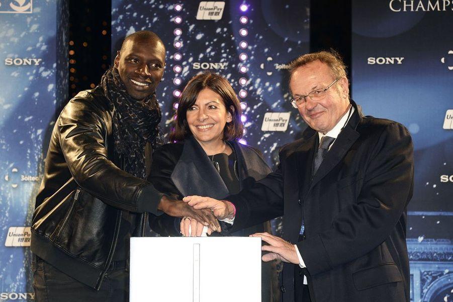 Omar Sy, Anne Hidalgo et Jean-Noël Reinhardt à Paris le 20 novembre 2014