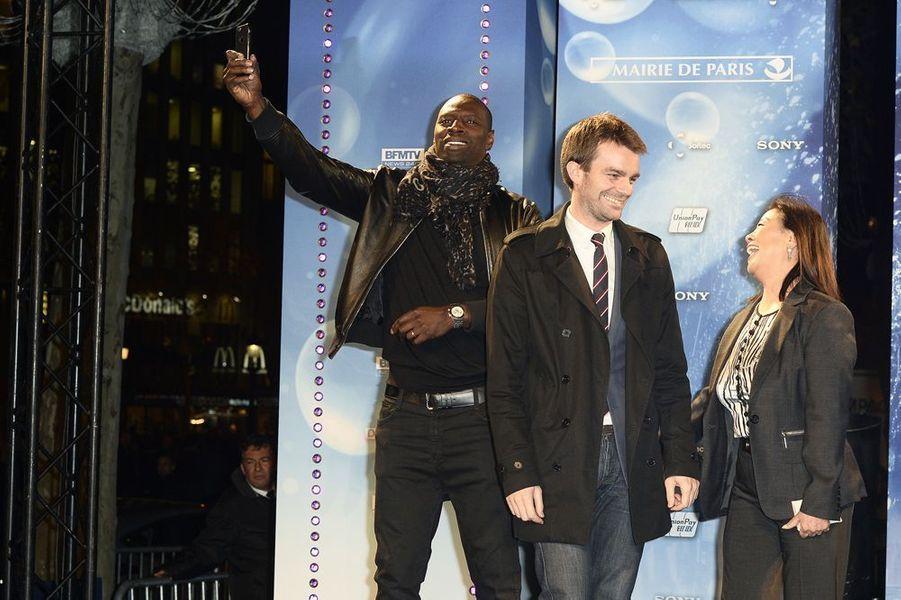 Omar Sy, Bruno Julliard et Jeanne d'Hauteserre à Paris le 20 novembre 2014