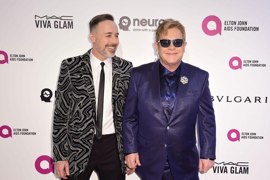 David Furnish et Elton John au gala organisé au profit de la recherche contre le Sida à Los Angeles le 28 février 2016