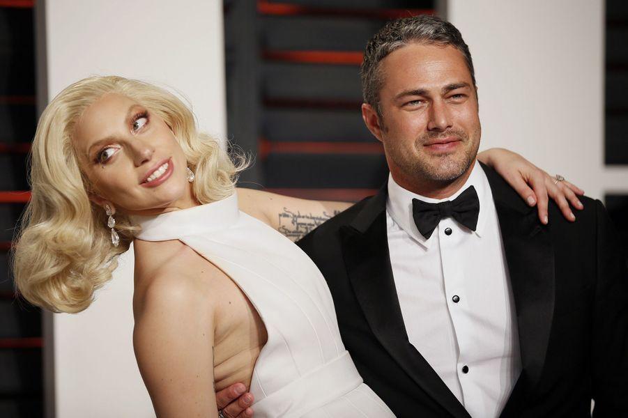 """Lady Gaga et Taylor Kinney à l'after-party du magazine """"Vanity Fair"""" le 28 février 2016 à Los Angeles"""