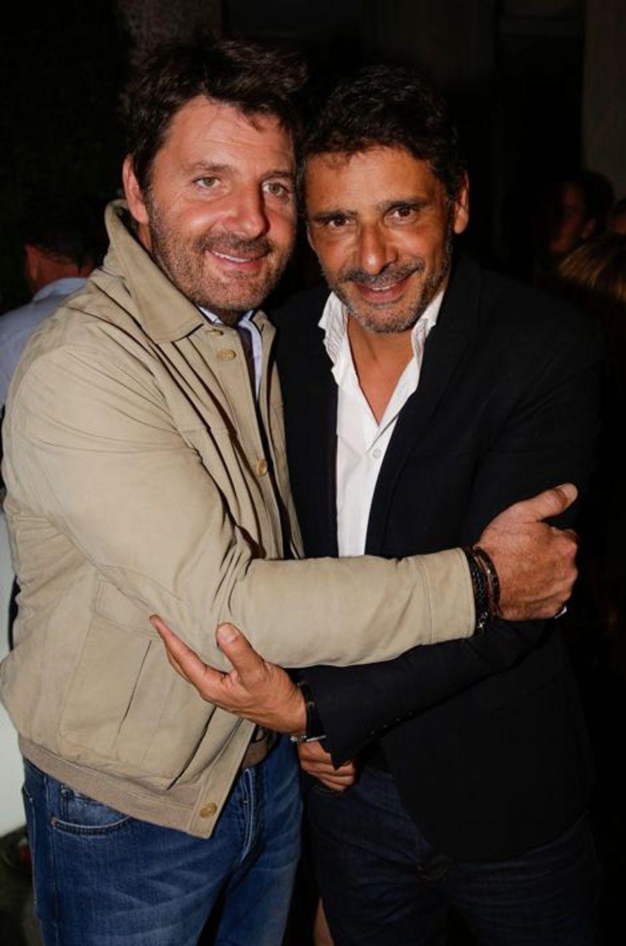 Philippe Lellouche et Pascal Elbé au 10e anniversaire de l'Hôtel de Sers à Paris, le 10 septembre 2014.