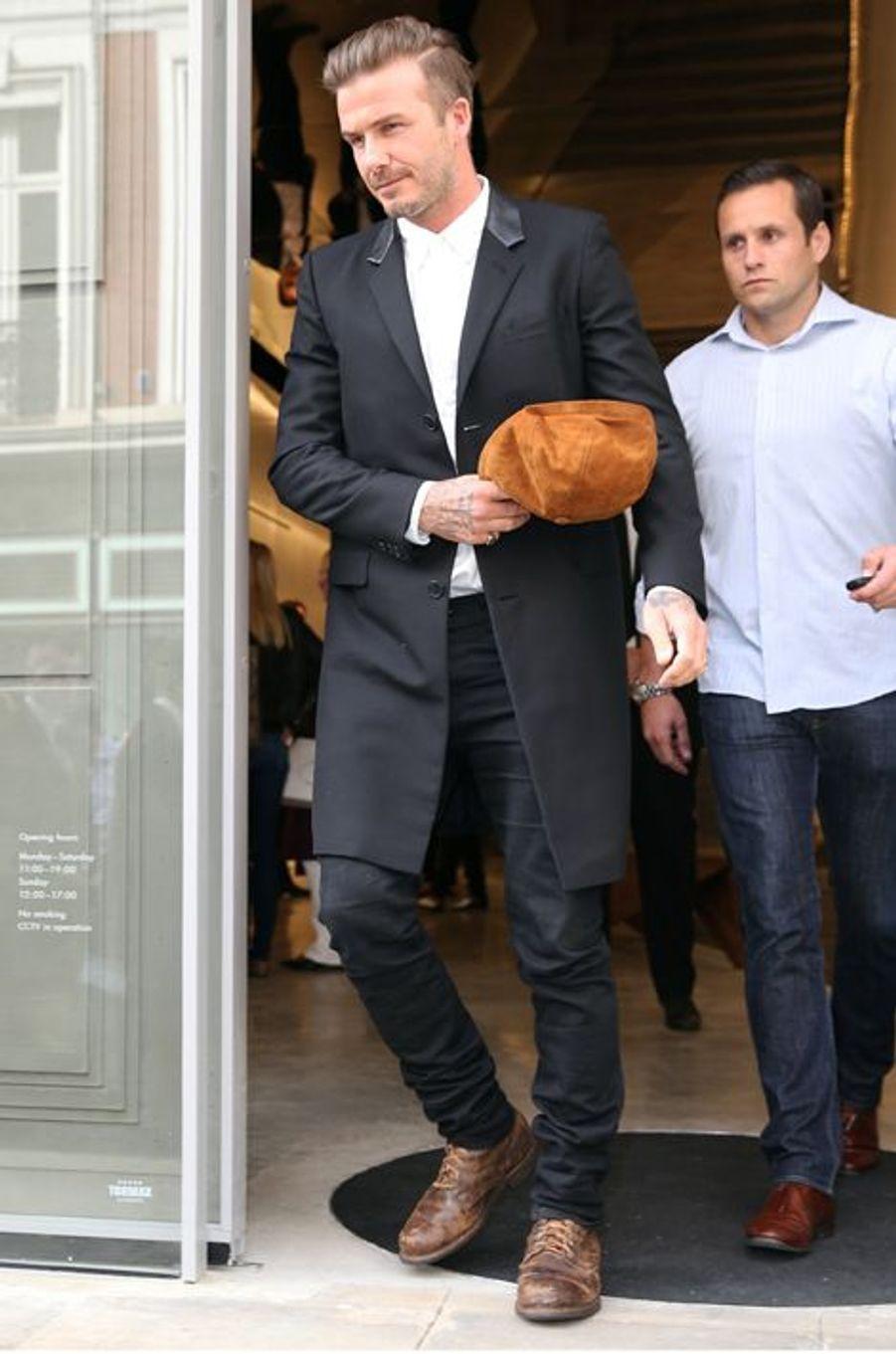 David Beckham lors de l'ouverture de la boutique londonienne de Victoria Beckham ce 25 septembre 2014.