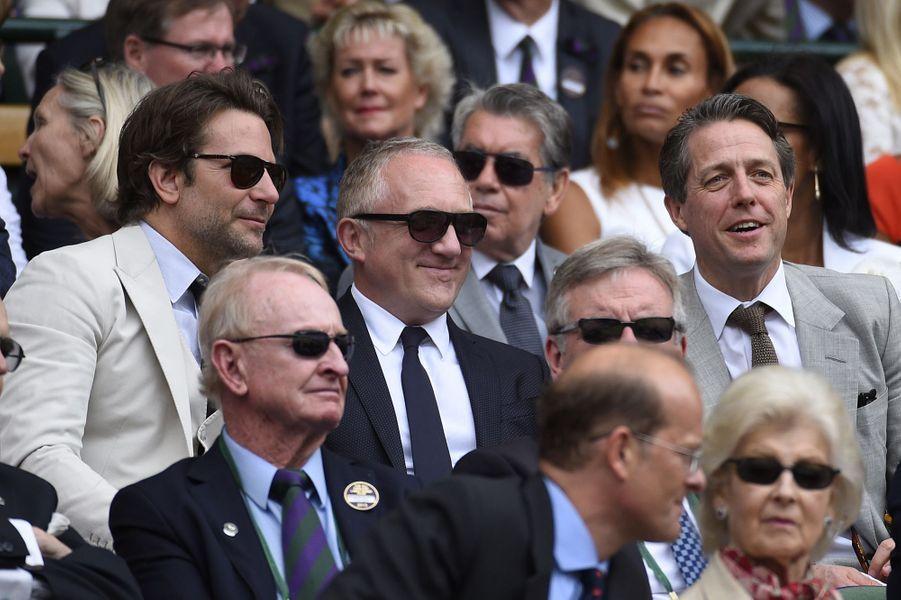 Bradley Cooper, François-Henri Pinault et Hugh Grant à Londres le 12 juillet 2015