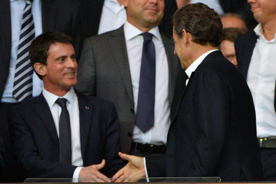 Manuel Valls et Nicolas Sarkozy à Paris le 15 avril 2015