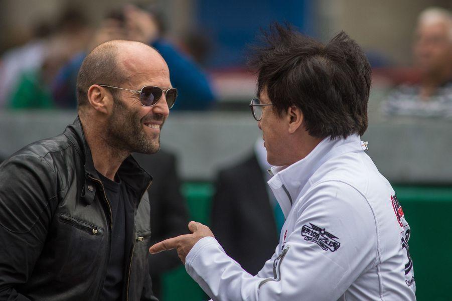 Jason Statham et Jackie Chan aux 24h du Mans, le 18 juin 2016