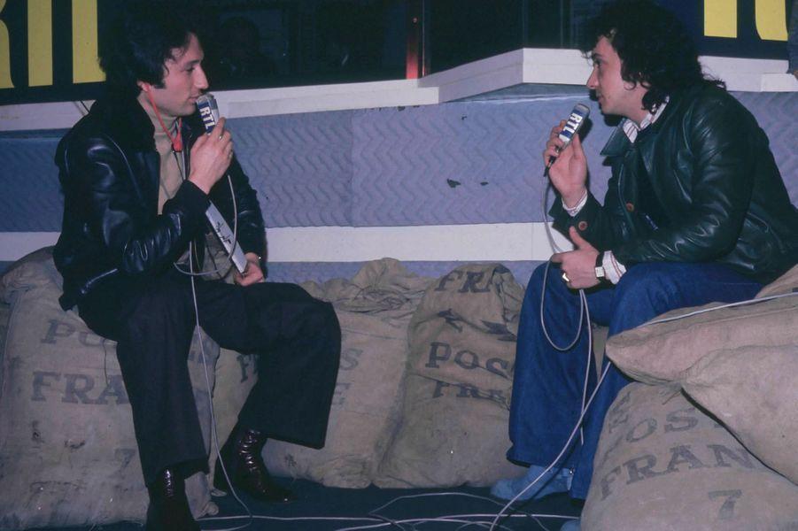 En compagnie de Michel Sardou pour une interview chez RTL en février 1975