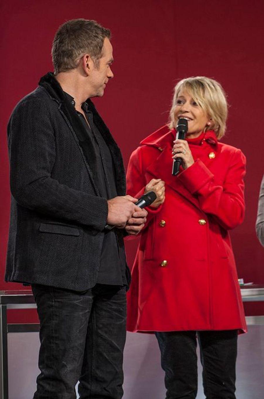 Garou et Sophie Davant au Téléthon 2014 à Paris, le 6 décembre 2014