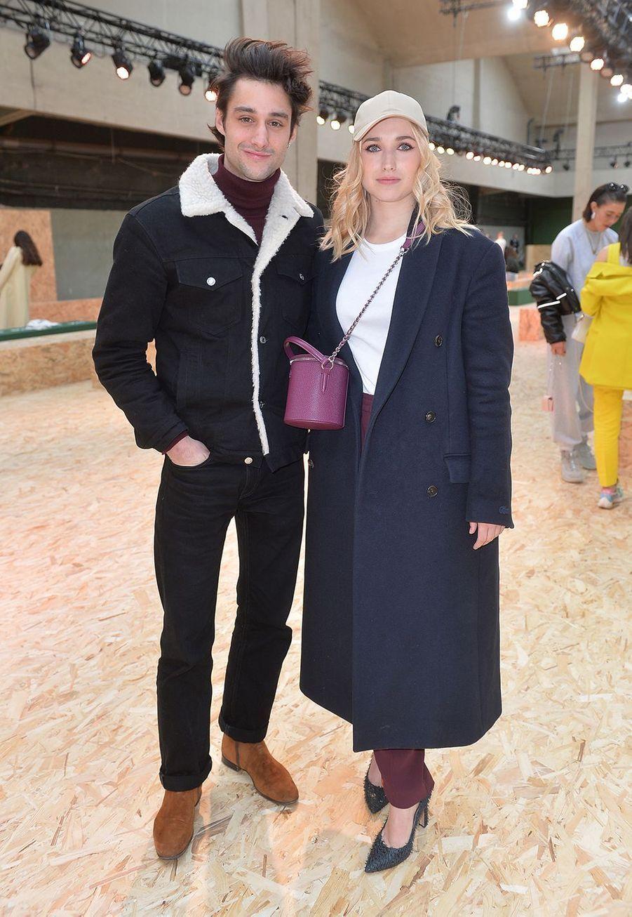 Chloé Jouannet accompagnéedeFélix Cordier au défilé prêt-à-porter automne-hiver 2020-21 Lacoste à Paris le 3 mars 2020.
