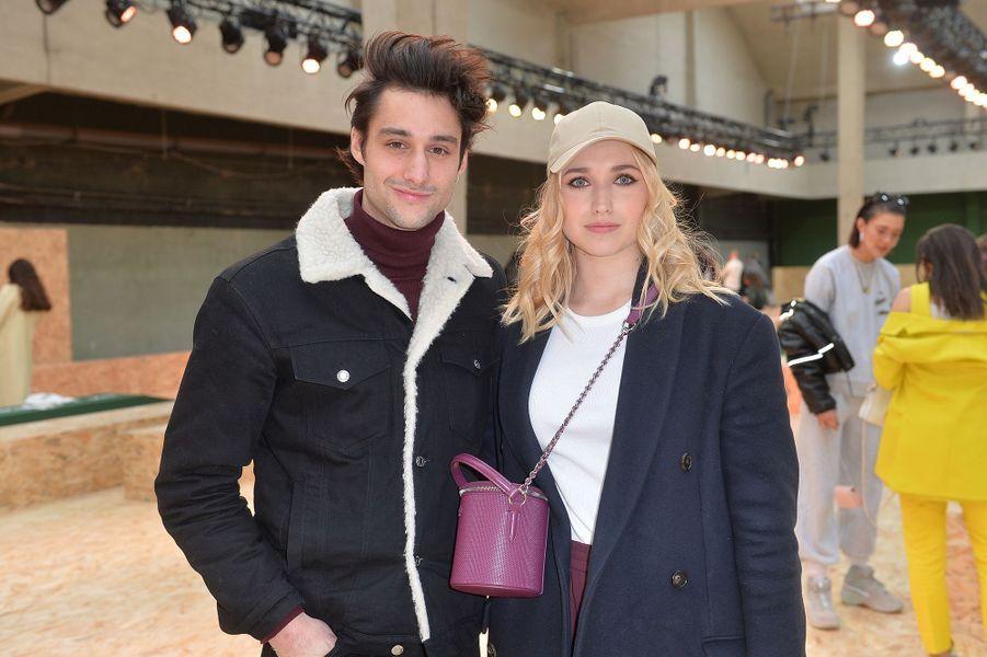 Chloé Jouannet accompagnée de Félix Cordier au défilé prêt-à-porter automne-hiver 2020-21 Lacoste à Paris le 3 mars 2020.