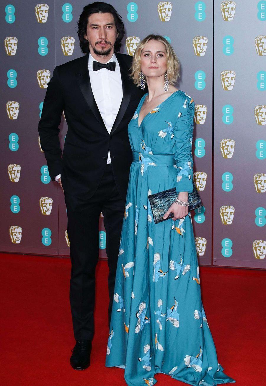 Adam Driver (en costume Celine by Hedi Slimane) et son épouseJoanne Tuckerà la73e cérémonie des British Academy Film Awards à Londres le 2 février 2020