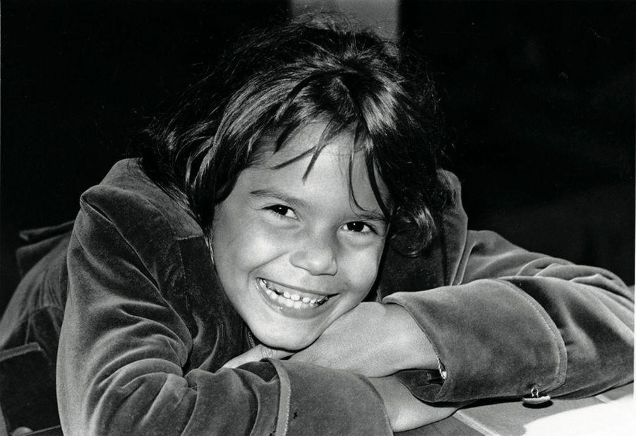 Le joli sourire de ses 9 ans lors de l'anniversaire de sa maman.