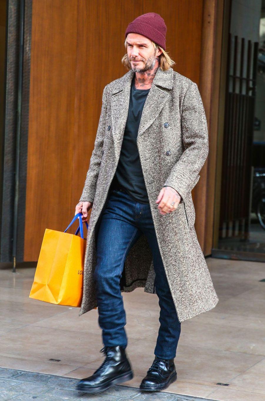 David Beckham sortant de la boutique Louis Vuitton à Paris le 17 janvier 2018