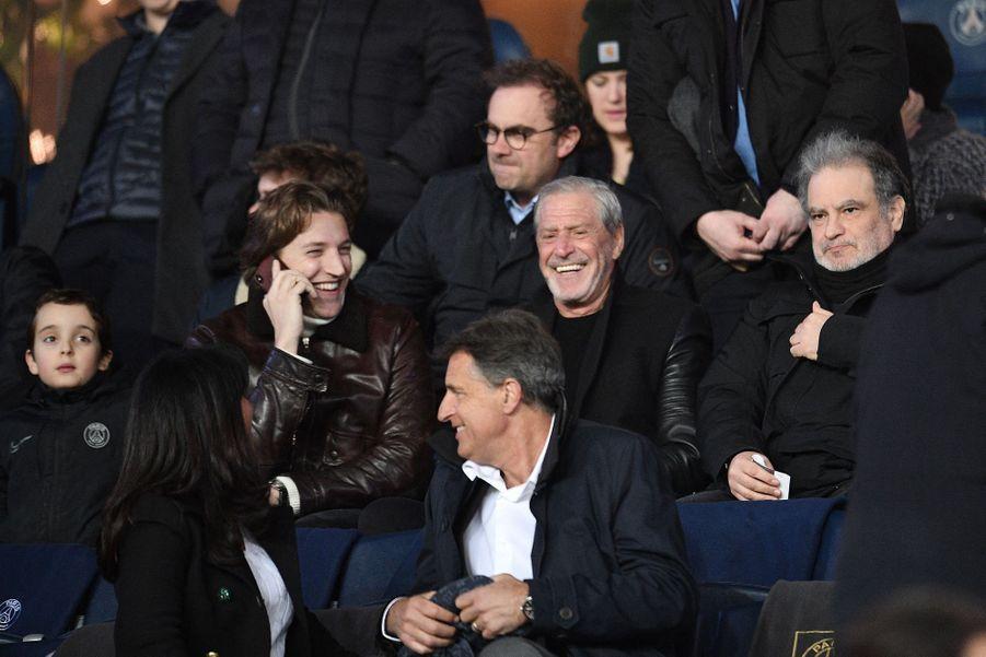 Jean Sarkozy, Jean-Claude Darmon and Raphael Mezrahi dans les tribunes du Parc des Princes, le dimanche 17 mars