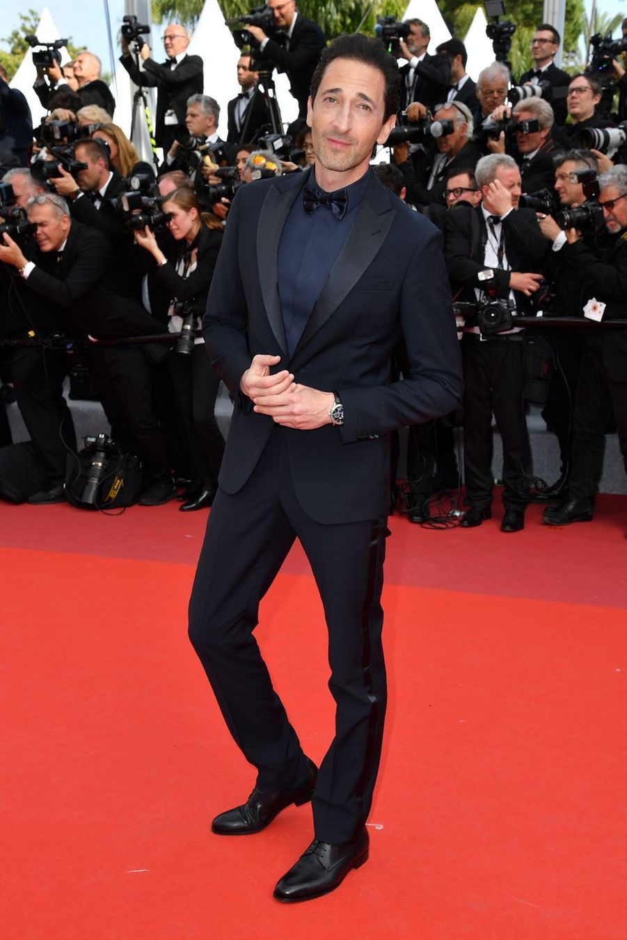 Adrien Brody (en Armani Privé) lors de la montée des marches du film «Once Upon A Time In Hollywood» à Cannes le 21 mai 2019