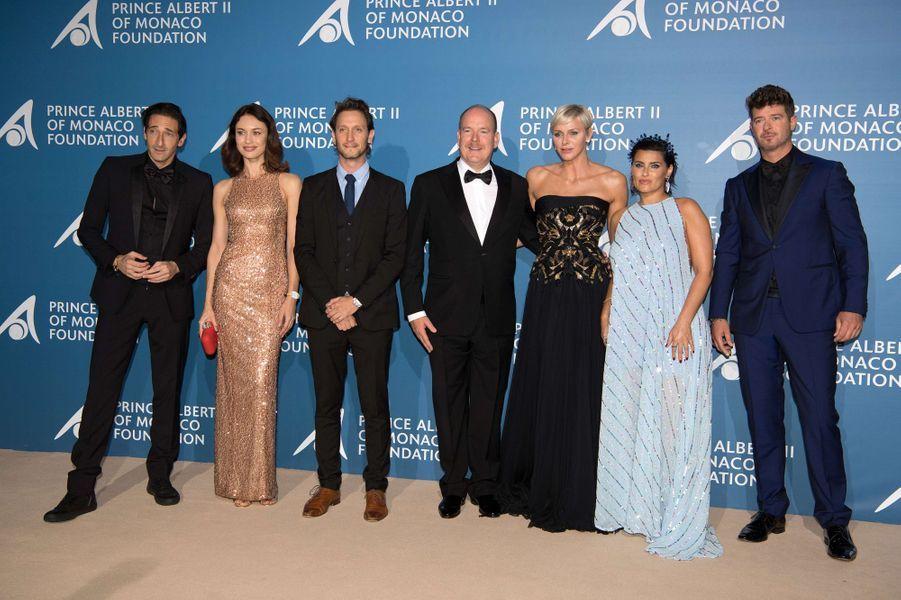 La princesse Charlène et le prince Albert II de Monaco avec Adrien Brody, Olga Kurylenko, Lior Suchard, Nelly Furtado et Robin Thicke à Monaco, le 28 septembre 2017