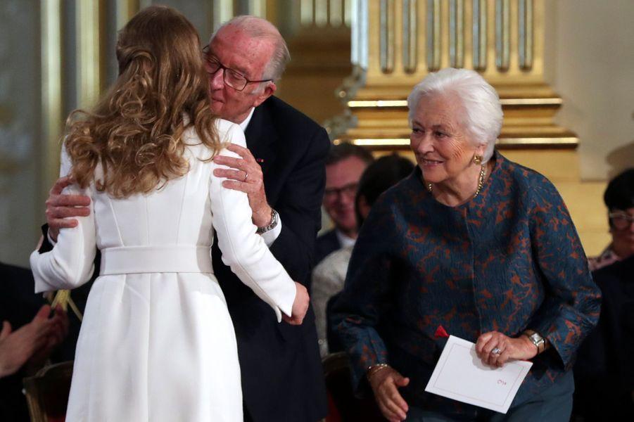 La princesse Elisabeth de Belgique avec ses grands-parents l'ex-roi des Belges Albert II et l'ex-reine Paola à Bruxelles, le 25 octobre 2019