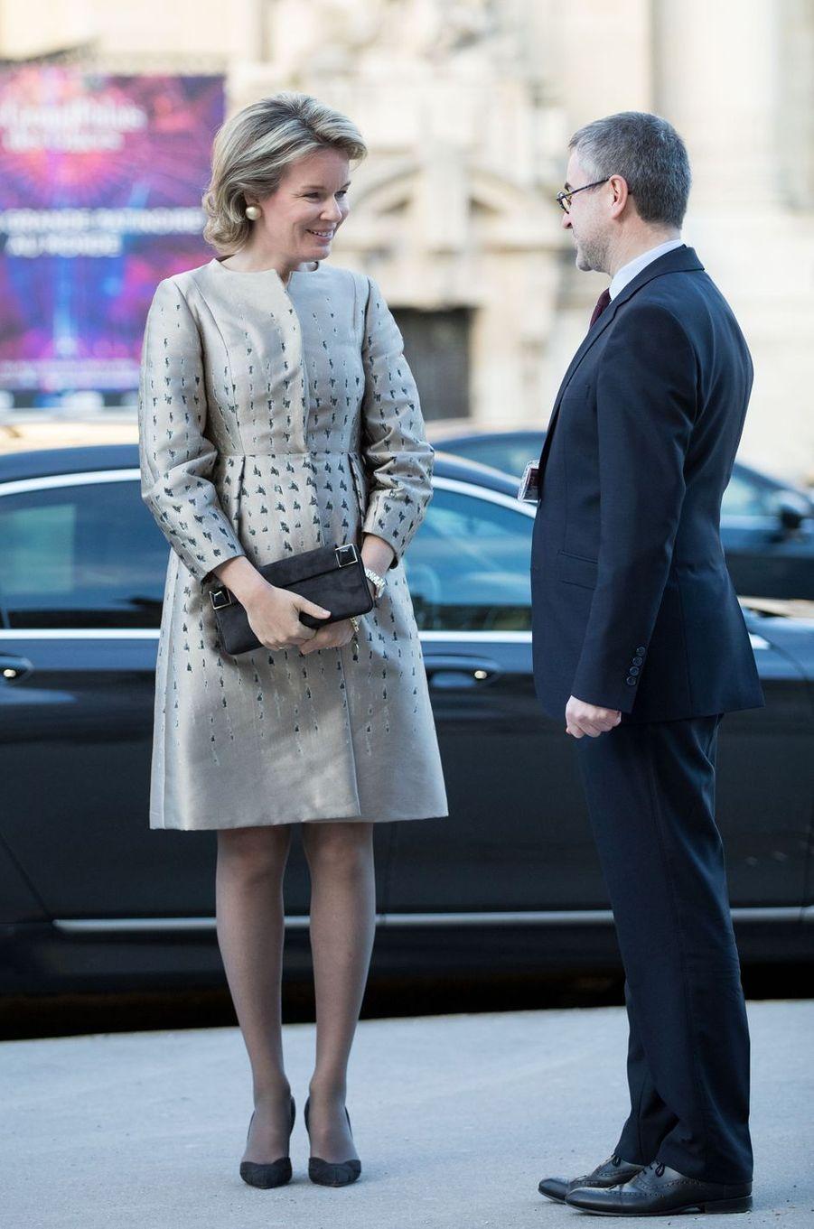 La reine des Belges Mathilde, dans un manteau Natan, à Paris le 9 janvier 2019