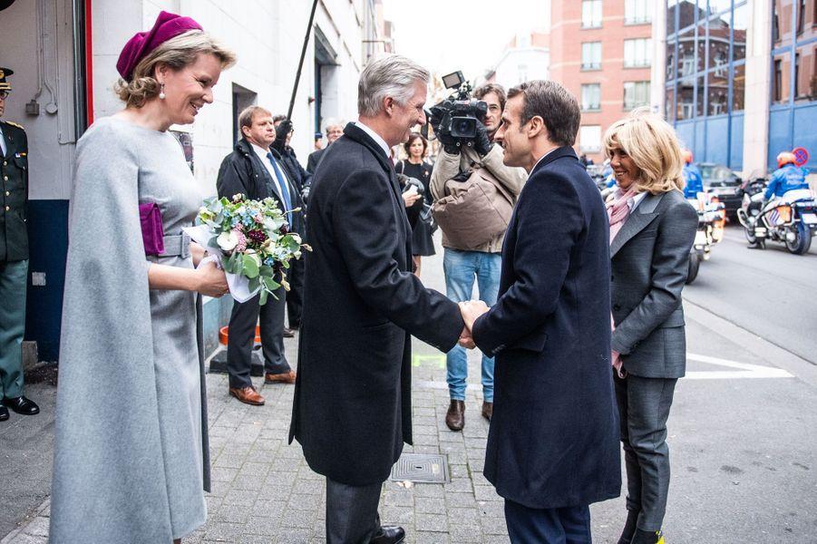 La reine Mathilde et le roi des Belges Philippe retrouvent Brigitte et Emmanuel Macron à Molenbeek, le 20 novembre 2018