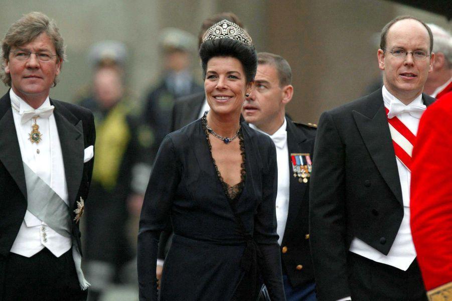 Le prince Albert de Monaco avec sa soeur la princesse Caroline et le mari de celle-ci le prince Ernst August de Hanovre à Copenhague, le 14 mai 2004