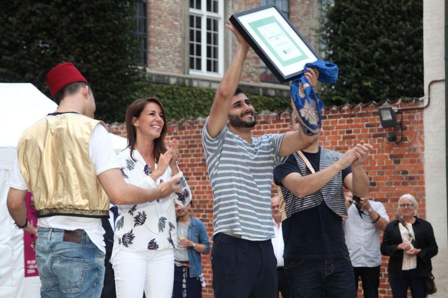 La princesse Marie de Danemark avec les chefs vainqueurs du concours de hot-dog à Copenhague, le 22 août 2016