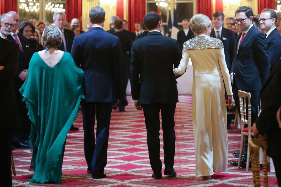 La grande-duchesse Maria Teresa et le grand-duc Henri de Luxembourg avec Emmanuel et Brigitte Macron à Paris, le 19 mars 2018