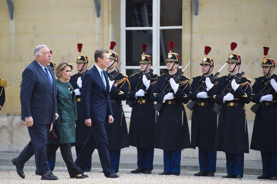 La grande-duchesse Maria Teresa et le grand-duc Henri de Luxembourg avec Gérard Larcher à Paris le 20 mars 2018