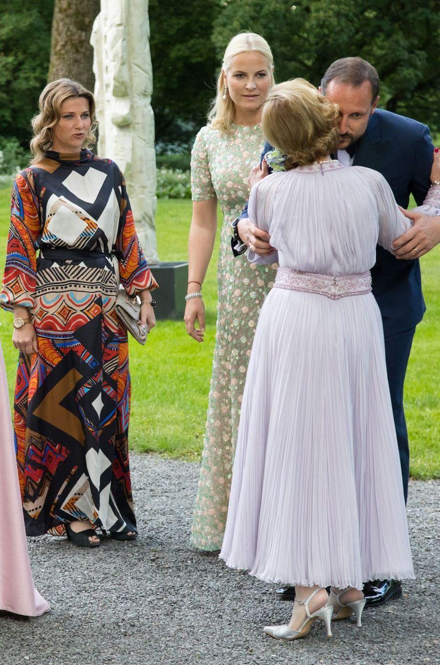 Les princesses Mette-Marit et Märtha Louise, le prince Haakon et la reine Sonja de Norvège à Oslo, le 4 juillet 2017
