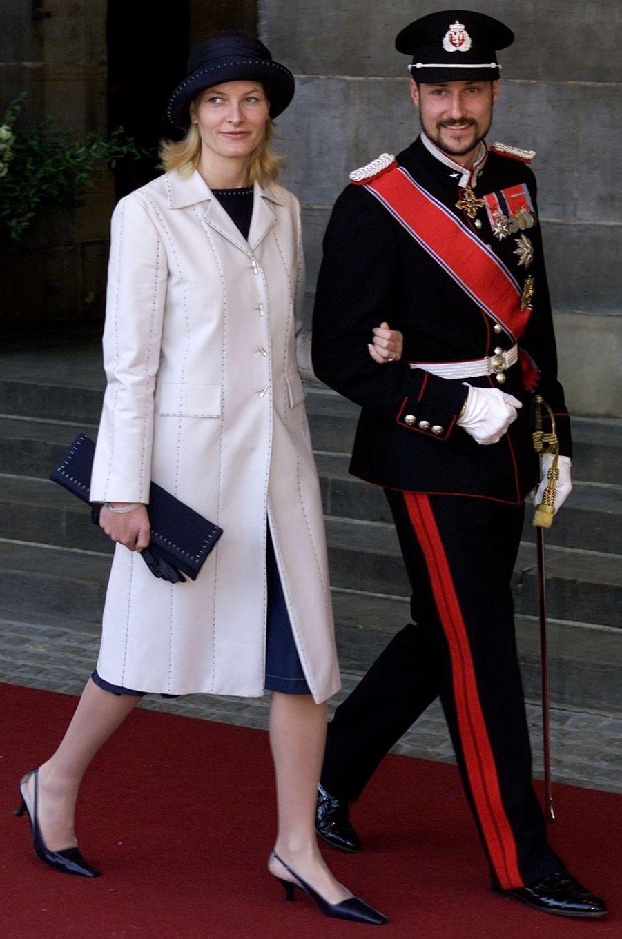 La princesse Mette-Marit et le prince Haakon de Norvège au mariage du prince Willem-Alexander des Pays-Bas etde Maxima Zorreguieta à Amsterdam, le 2 février 2002